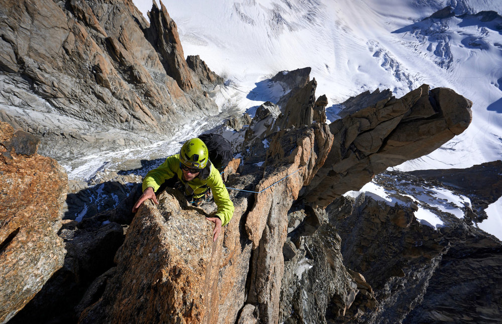 Tim climbing above some big exposure near the top of la Pointe Chaubert, the second tower on the ridge