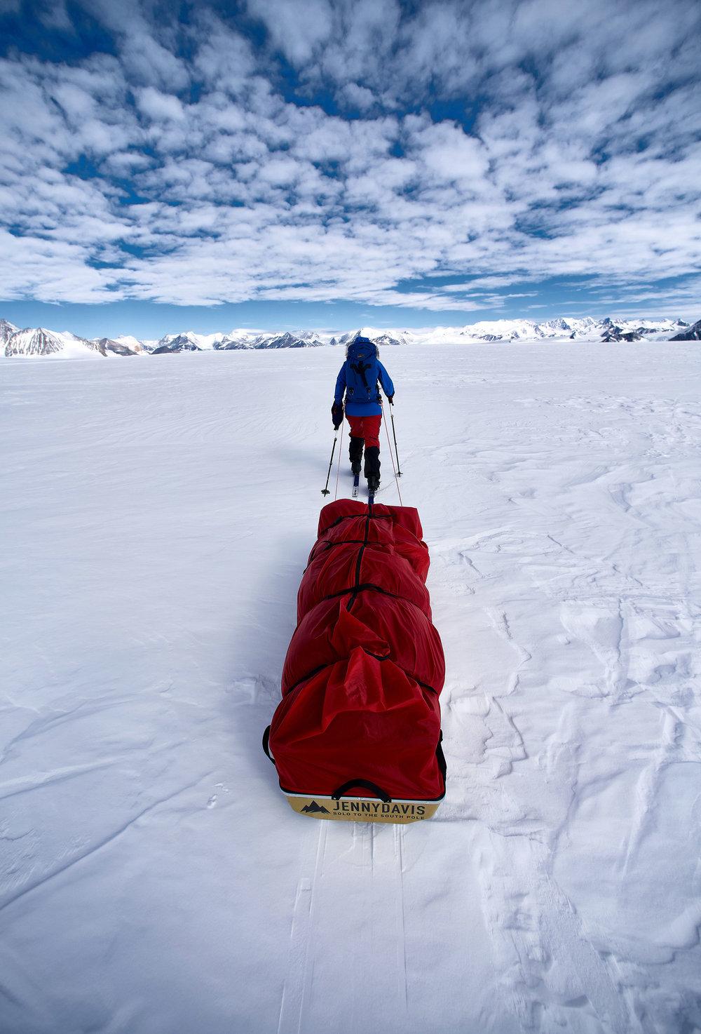 Jenny Davis practising hauling her sled near Union Glacier camp