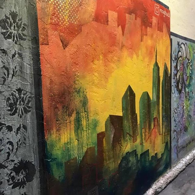 Featured Artist: Maggie Mejia @maghack. Catch Maggie's work in the tight alleyway tucked behind @abraxasbooks. You may have met her at one of our events curating a craft booth or seen her prints or postcards around town. Thank you Maggie for helping get our community create. #art #alley #florida #daytona #murals #abstract #city #crafts #artists #creativity #paint