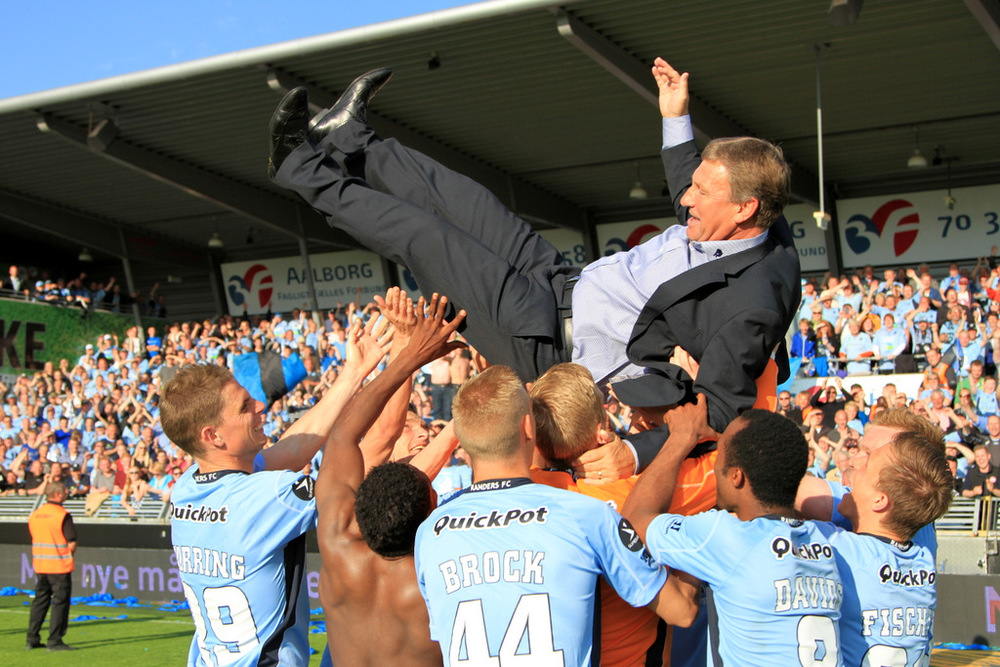 Randers FC celebrate a bronze medal in 2013 for finishing third in the league