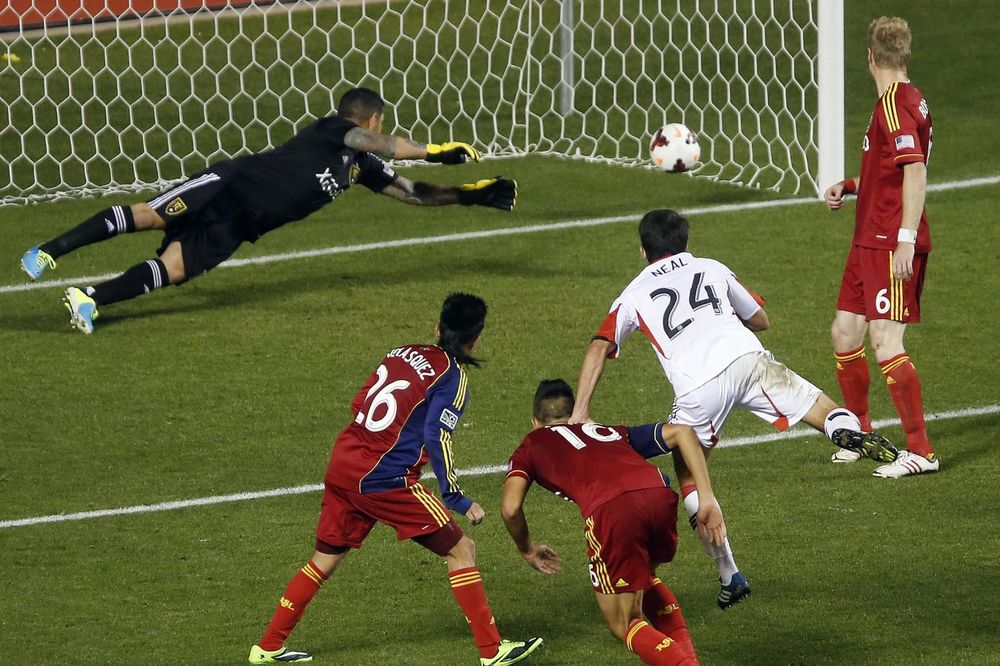 Neal heads the winner for DC United against Real Salt Lake City in 2013