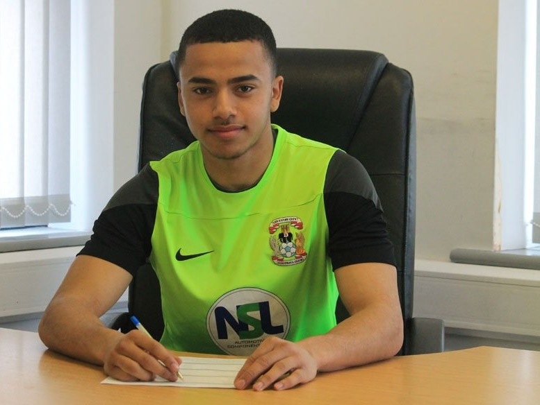 Signing professional terms with Coventry City