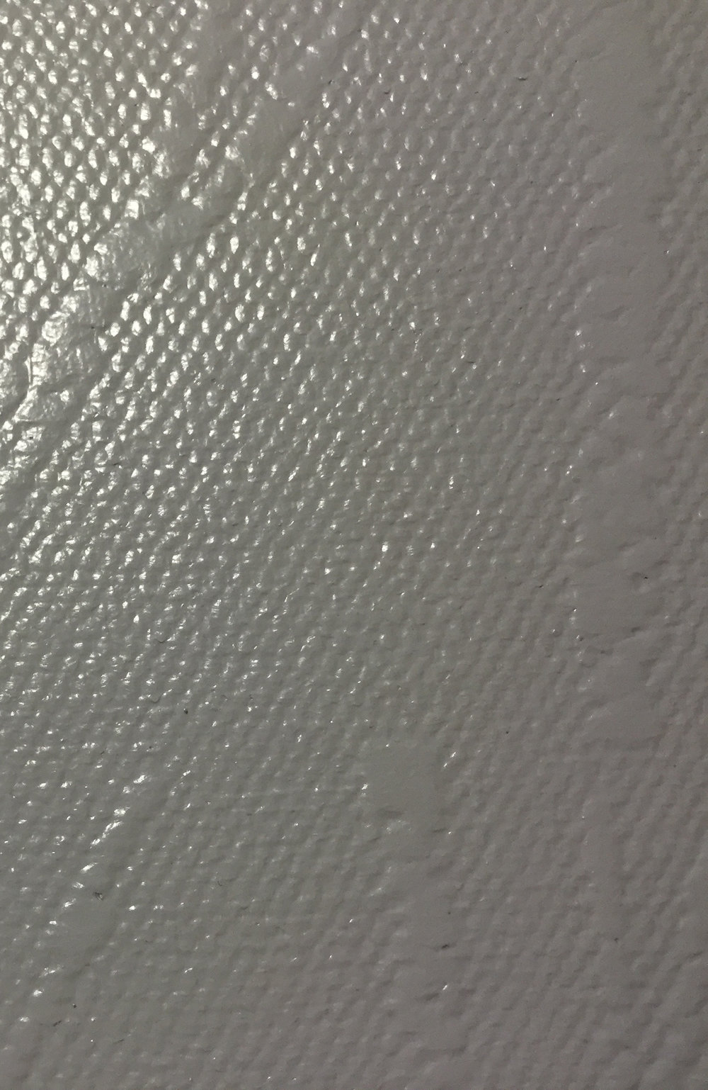 (above: VRP wallcovering comes in a wide variety of textures; far above: a sample microvented vinyl)