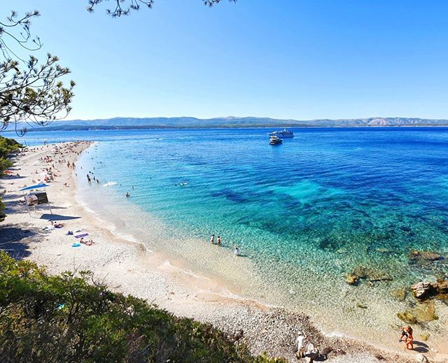 I call it Z-Rat for short. Zlatni Rat has been named one of Croatia's best beaches several times and I can see why! The white V-shaped peninsula against the insanely blue waters of the Adriatic sea make it a true sight to see. Get there early or come late, it gets packed during peak hours. #Brac #Croatia