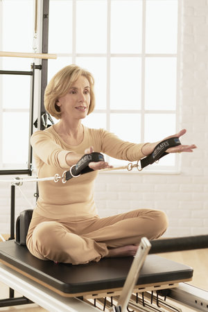 - A variety of exercises in the STOTT PILATES 'Reformer' repertoire can be performed in a comfortable, 'seated' position.