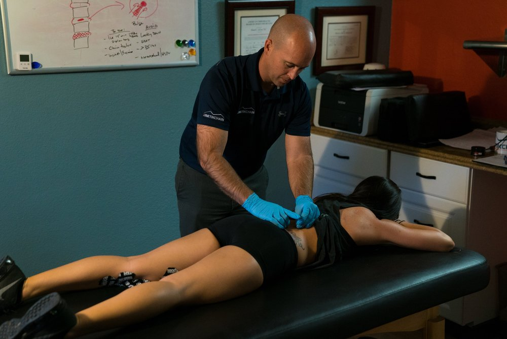 Dry Needling is used here by physical therapist Jamie Bovay to help reduce pain and improve muscle activity for lower back pain at our Denver Clinic.