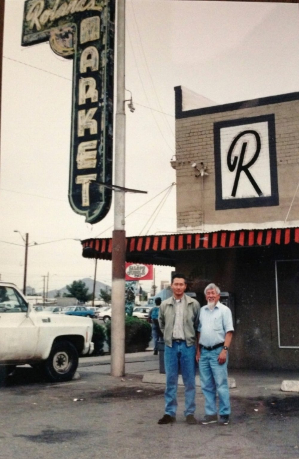 Kai with the Korean grocer that bought Roland's Market in the 1980's
