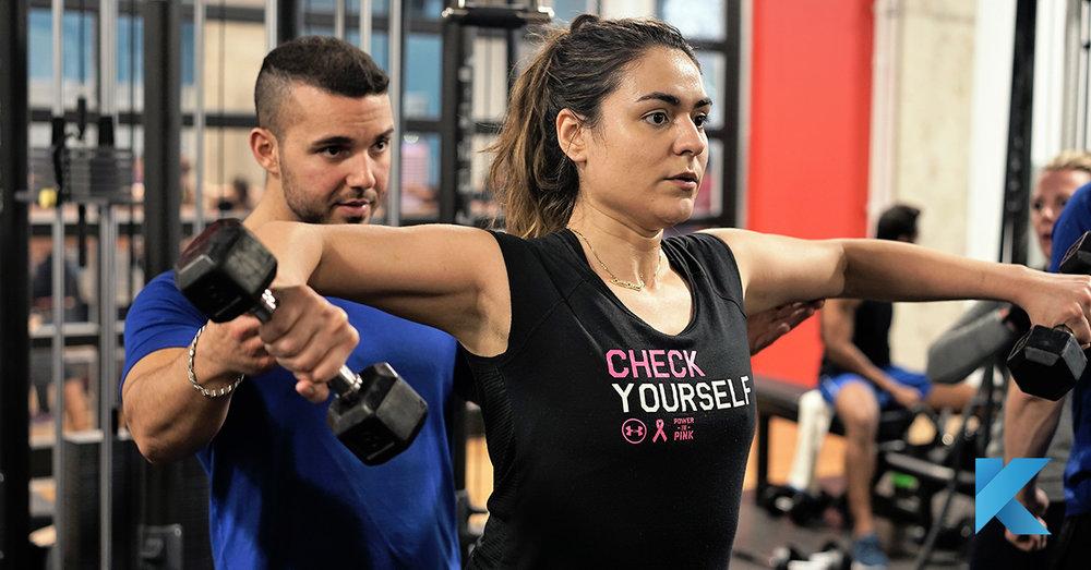 personal trainer helping client klub athletik.jpg