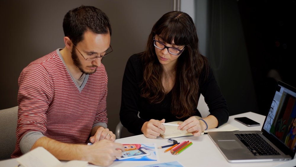 Pietro and Arianna working on new illustrations.jpg