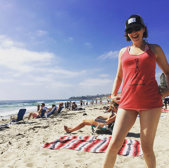 WoA girl at the beach after learning to surf in San Diego.