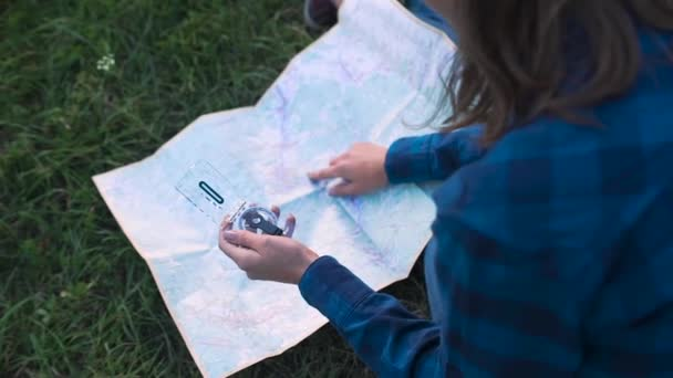depositphotos_193371108-stock-video-woman-traveling-using-map-compass.jpg