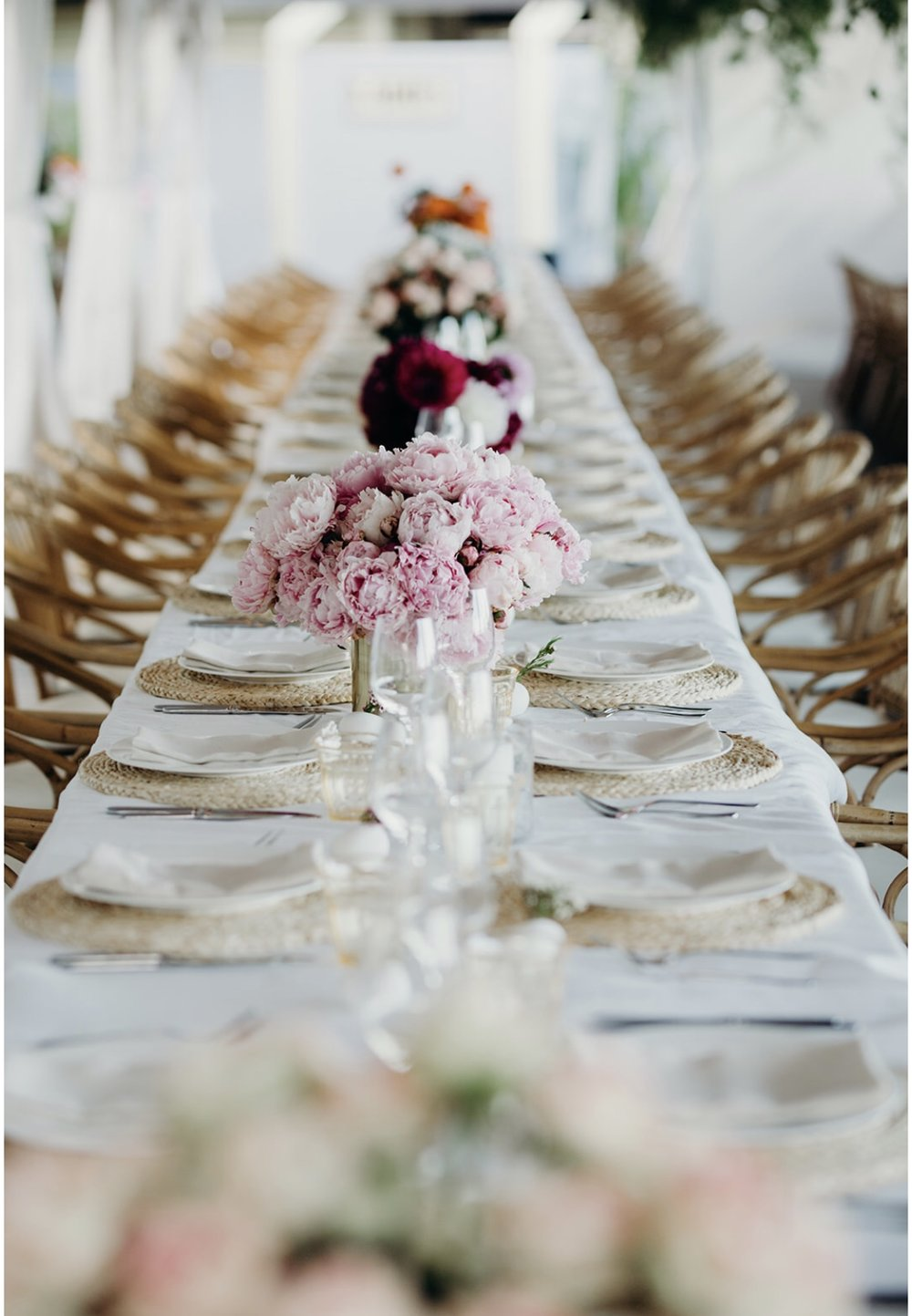 Table settings & bunches of bright florals. Image by Folk & Follow