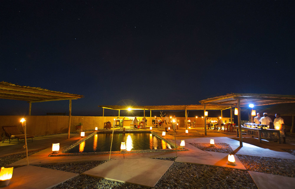 Kulala Desert Lodge Pool Area by Latern Light.jpg