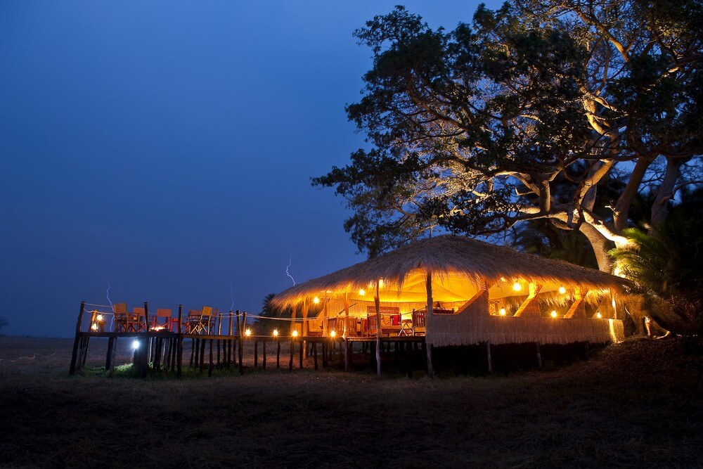 Mukambi Plains Camp at night.jpg