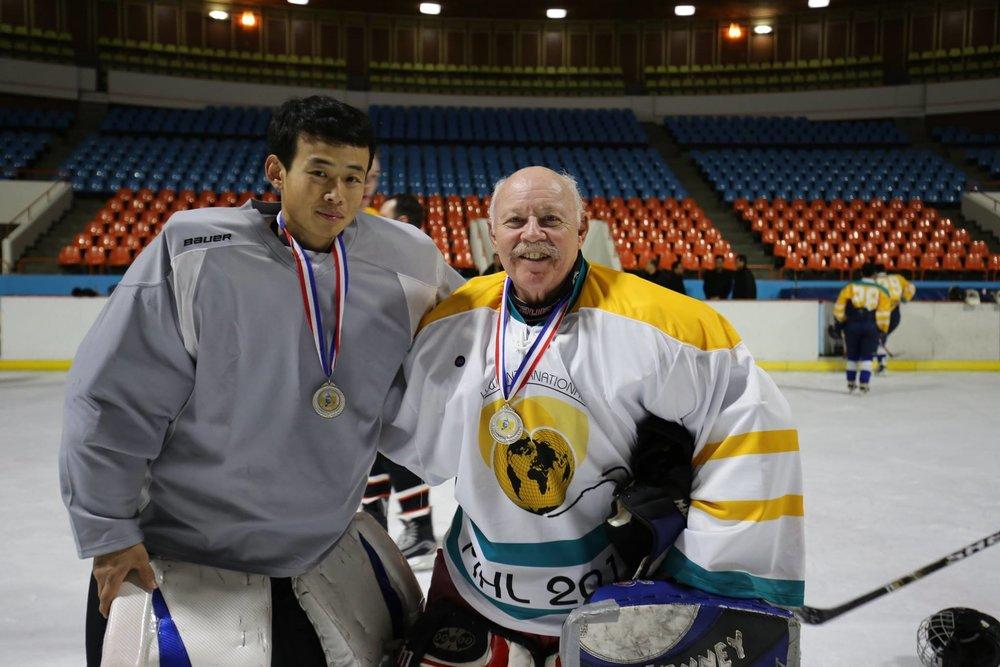 Yellow White Blue hockey uniforms jerseys