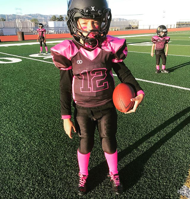 Black white and pink football uniform jersey and pants
