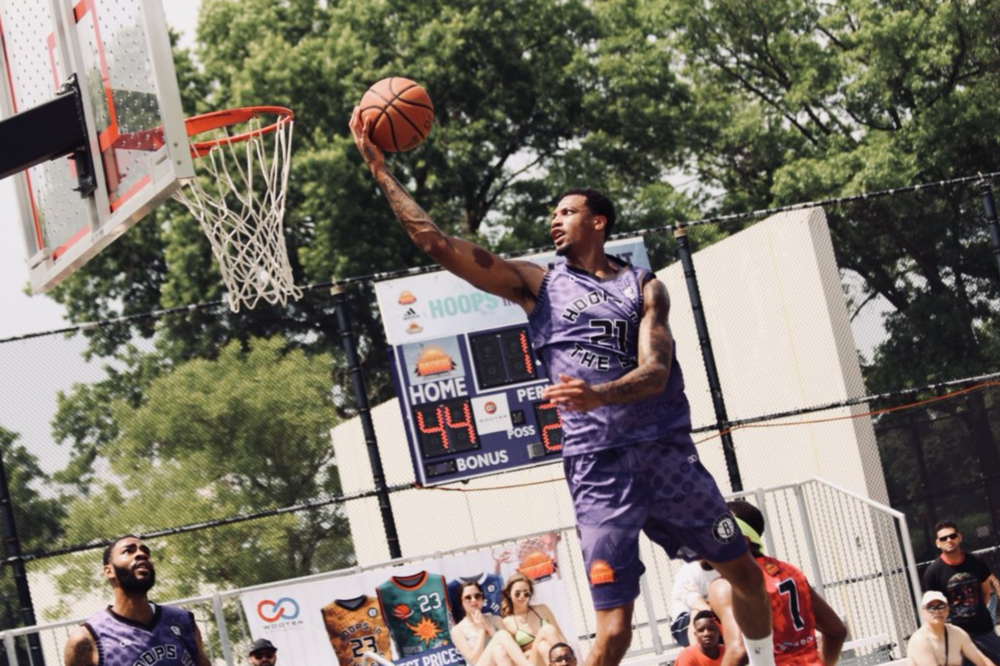 """HITS Maker:  Hoops in the Sun (HITS) was created by Rufino (Joe) Cruz, Sr. and his two sons in the Summer of 2000 and has remained a go-to basketball and community event each summer at Orchard Beach, and since """"Pops"""" passing in 2004."""