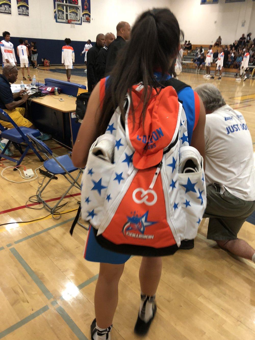 Women's COLLISION Orange Blue White basketball backpack