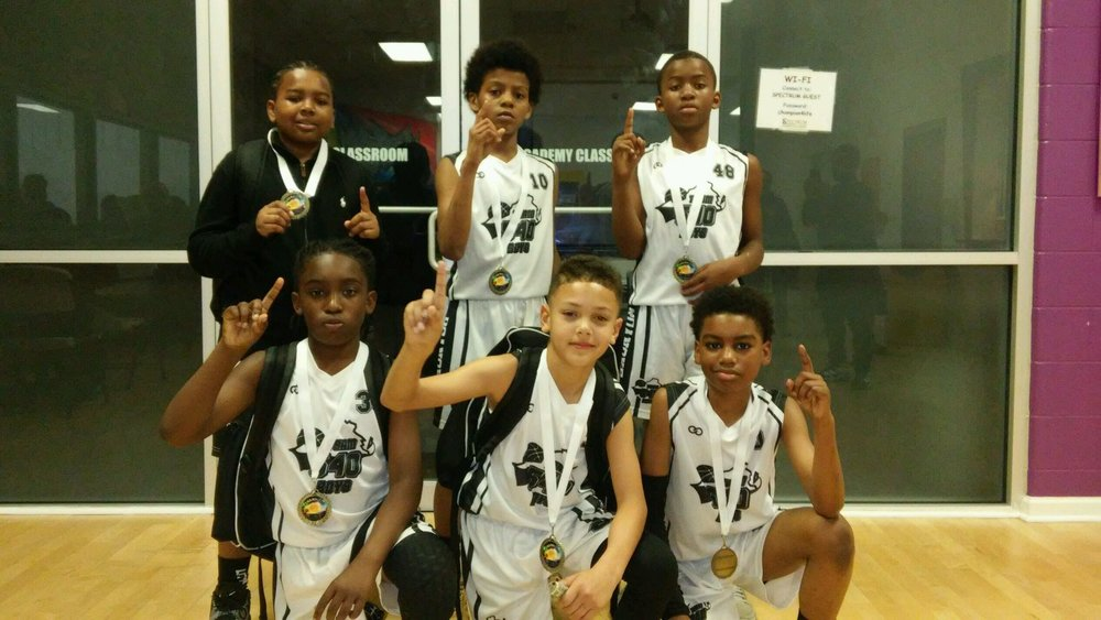 Youth 540 BOYS White Black basketball uniforms, jerseys, and shorts