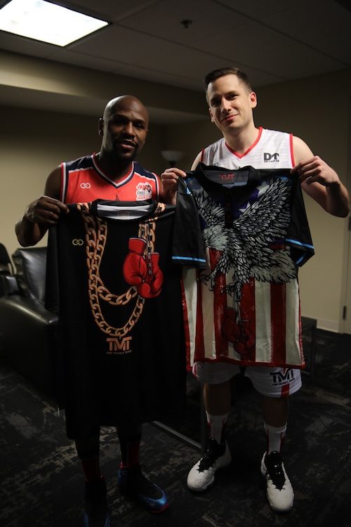 The Champ Is Here: Alex Aleksandrovski, Co-Founder and CEO of Wooter, presents Floyd Mayweather with some customized TMT merch from Wooter Apparel.