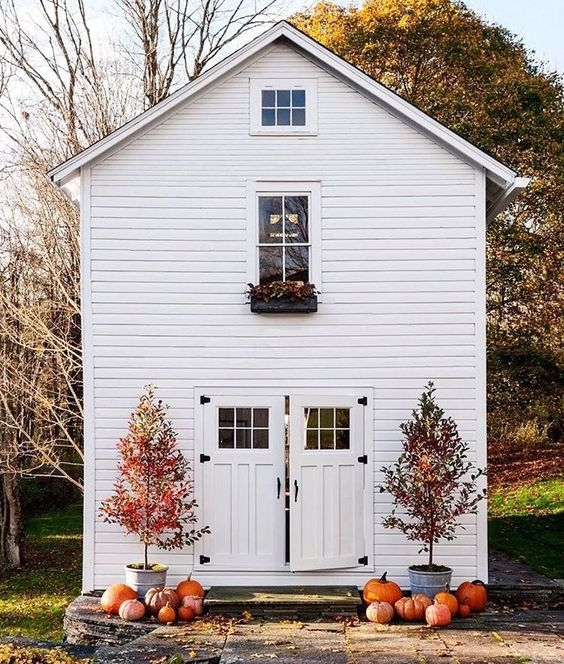 white home exterior with fall decor