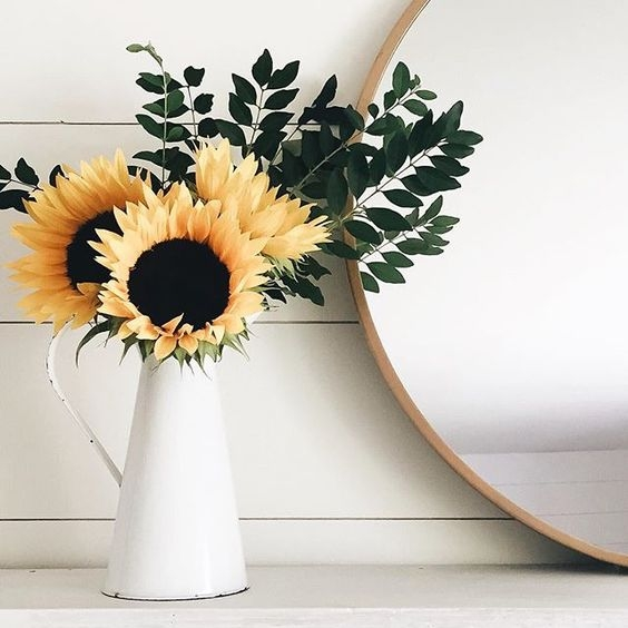 shiplap and sunflower on mantle