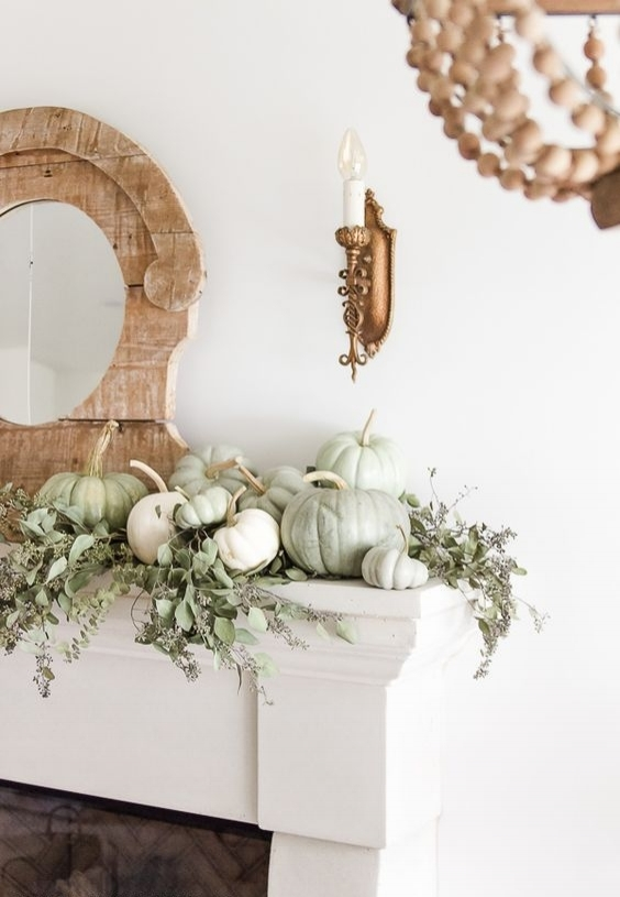 mantle with green and white pumpkins