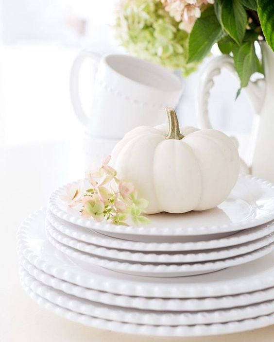 white place settings with white pumpkin