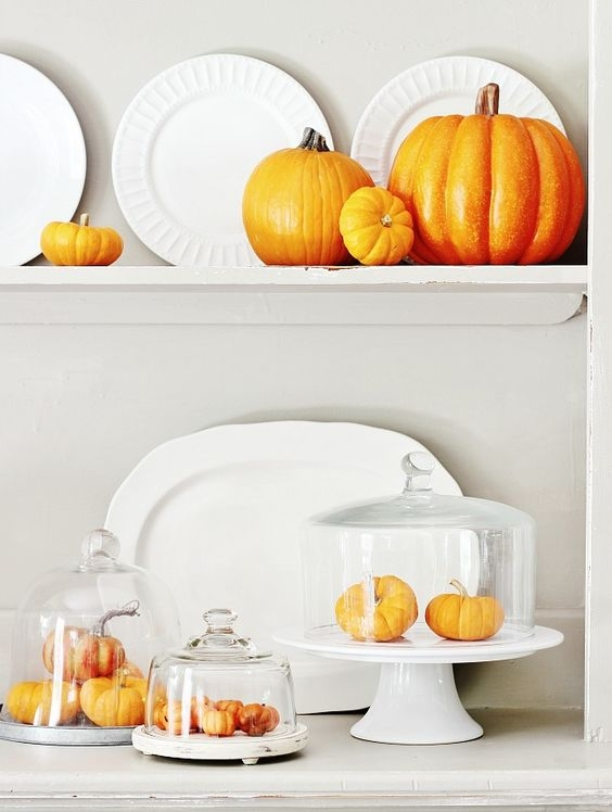 white serving platters with pumpkin decor