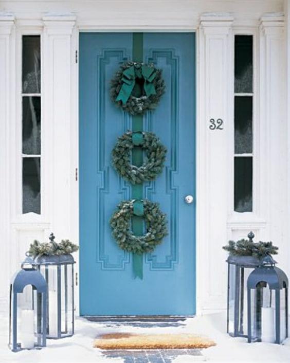 blue door with wreaths