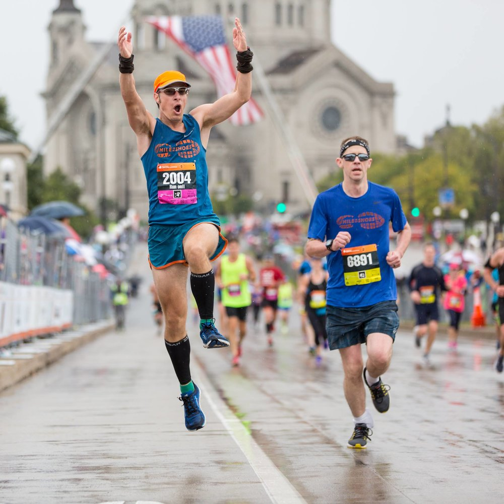 MiMS Distance Coordinator Joe Rauch runs (and jumps) the 2017 Twin Cities Marathon with Resident Member Brian