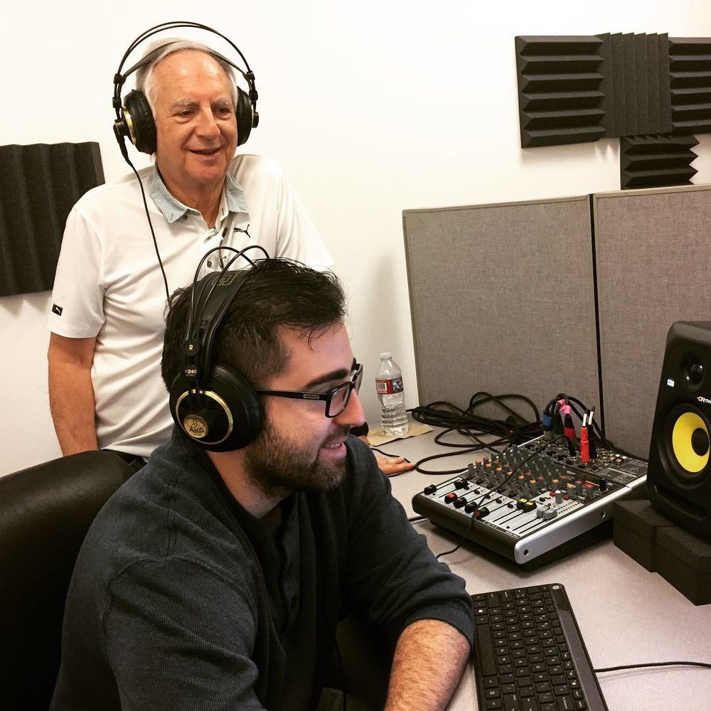Caption: Father-son duo, Ron and Max Cutler, recording an episode of Remarkable Lives Tragic Deaths