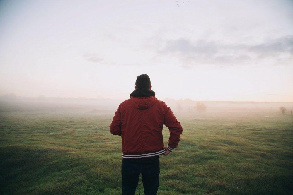 man-standing-in-meadow.jpg