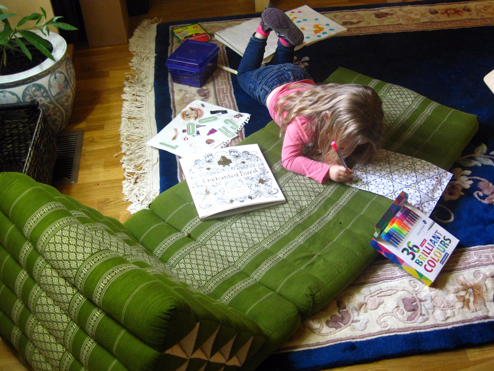 Sometimes my daughter and I enjoy coloring together - I in my coloring book, she in hers (or her sketchbook behind her)