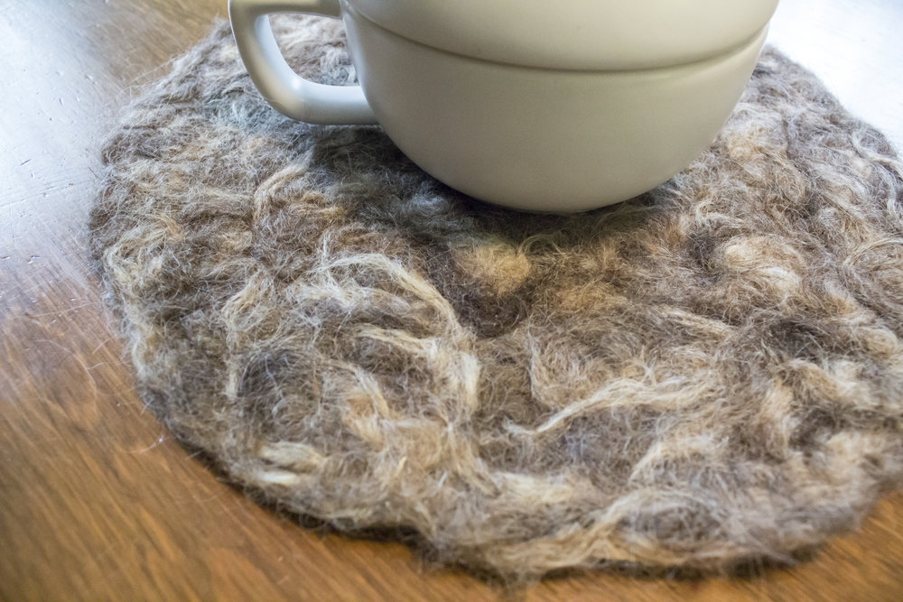 I needle felted this trivet using the felting machine and handpiecing Icelandic fleece locks together.