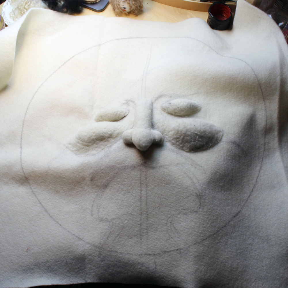 I'm starting out by using core to fill in the facial features, even though this piece is mostly 2D. It will be like a relief. The hoop for this project is two feet in diameter.