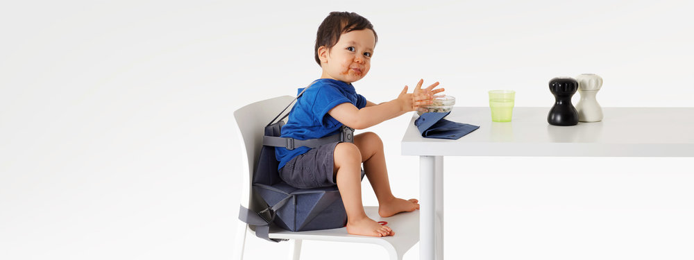 Bombol Foldable Pop-Up baby booster with messy kid.jpg