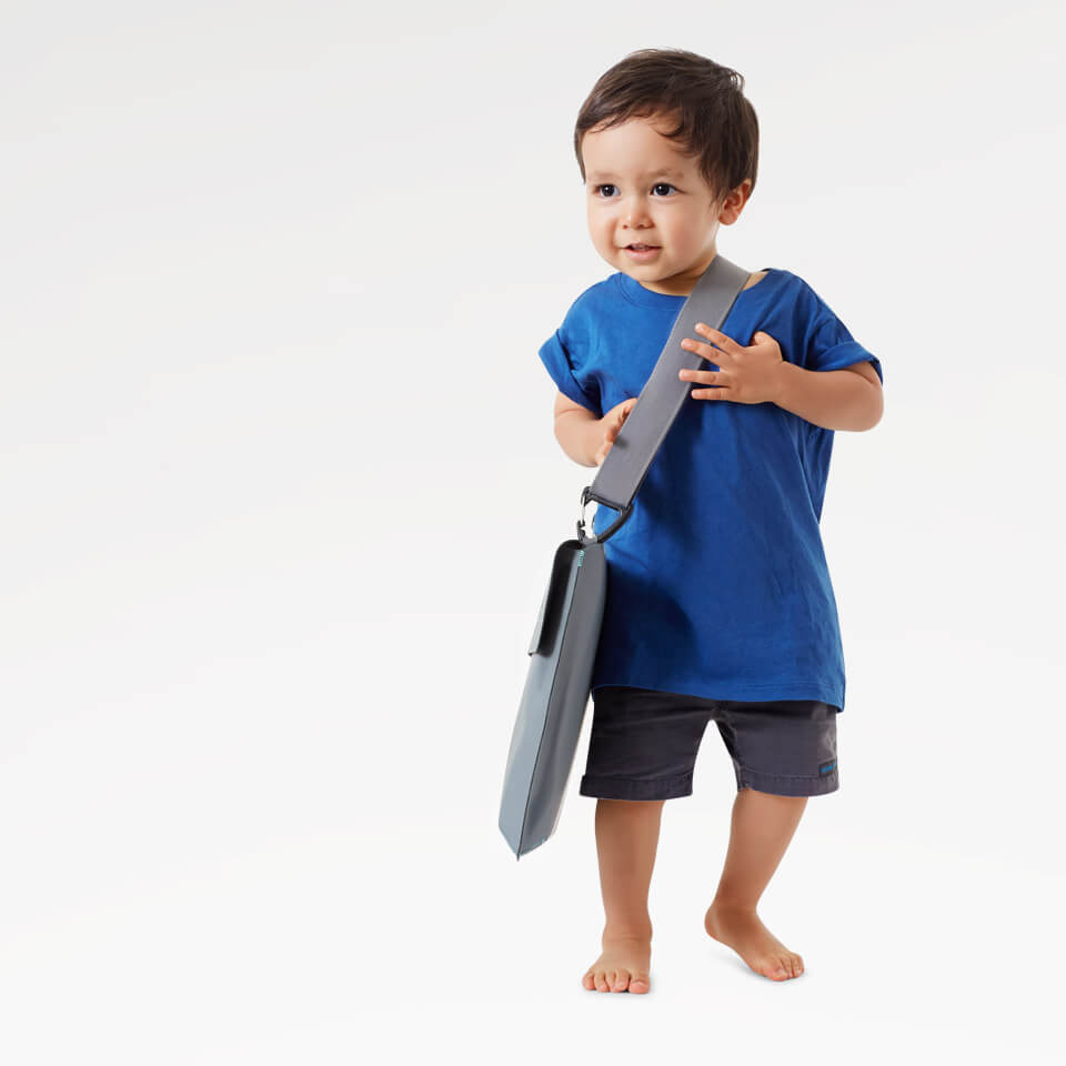 Kid carrying Bombol Foldable Pop-Up baby booster .jpg