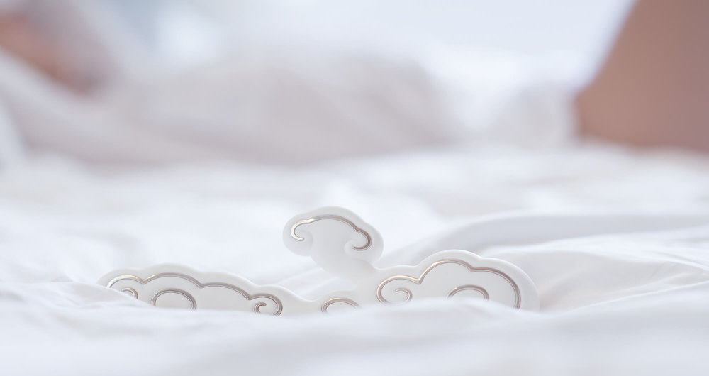 Ave-Sky- sensual-cloud-adult-toy-on-bed-sheets.jpg