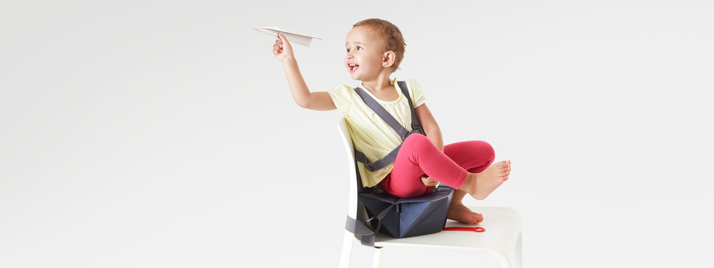 Bombol-Pop-Up-foldable-booster-seat-moving-kid-with-paper-plane.jpg