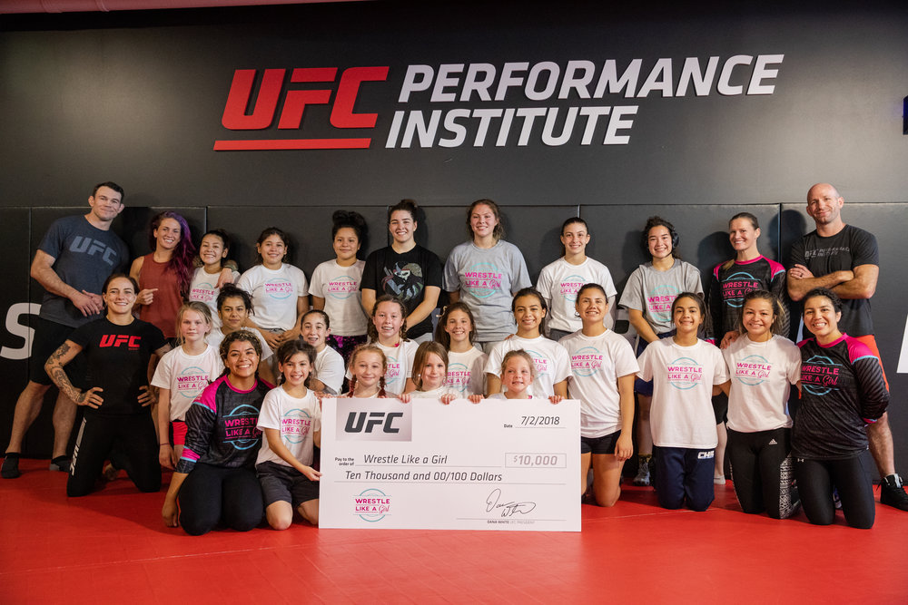 "UFC, Wrestle Like a Girl team up for Empowerment Camp and Clinic at UFC Performance Institute - MMAJunkie.com - By: John Morgan and Ken Hathaway | July 3, 2018 3:30 pmLAS VEGAS – The UFC's latest International Fight Week kicked off Monday with a couple of fighters teaching the community to wrestle like a girl.UFC fighters Jessica-Rose Clark (9-5 MMA, 2-1 UFC) and Gina Mazany (5-2 MMA, 1-2 UFC) teamed up with Wrestle Like a Girl to host a wrestling clinic at the UFC Performance Institute for aspiring female amateur wrestlers between the ages of 5 and 18.""What our goal is, is to bring to them the sport of wrestling so they can learn how to fight – fight for their sport, fight for their physical activity, fight for their values, fight for their beliefs – knowing that the mothers, the women in this world, they're the caretakers of our families, of our planets,"" Wrestle Like A Girl Founder and Executive Director Sally Roberts told MMAjunkie. ""They're the ones that are able to help really bring something special to the table, and by helping them learn how to fight, we can help empower them in a level that is unprecedented.""Girls from Nevada and six other surrounding states attended the clinic, which Roberts said focused not just on wrestling technique, but also the empowerment of attendees in hopes of potentially changing the trajectory of their life – which the Wrestle Like a Girl founder says she did through her own experience in the sport.After hosting the clinic, UFC officials also presented the organization with a donation of $10,000.Roberts – a former wrestling national champion, as well as an Army Special Operations veteran – believes that the UFC's assistance efforts could not only change participants' lives but also help find future athletes willing to step into the octagon, which will only help increase the quality of competition.""You're going to get more people tuning in,"" Robert said. ""You're going to be able to draw on more sponsors that are able to recognize the value because now you're opening up even more to the other half of the population, so this is just a wonderful fit between local organizations because it's not just impactful on the family trajectory and the family lives, but what happens in the business world when you see you can include women and still be successful.""###"