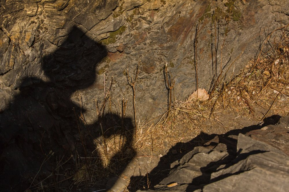 Above: In the shade and shadow lines, a farmer and I rest along a trail in Yunnan Province in China to exchange stories.