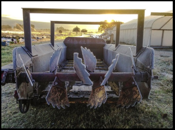 Our compost spreader, coated with frost on a 20 degree morning last week.