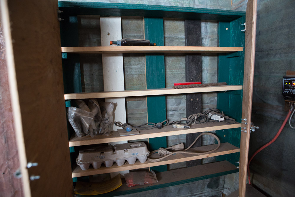 No barn isn't a barn unless it has shelves, closets, or in this case, a medicine cabinet. There's a fence tester, repair supplies for the mobile-electric fence, some first aid supplies, and, in that egg carton, fake eggs when new birds have to be shown and encouraged to lay in the rollout boxes.