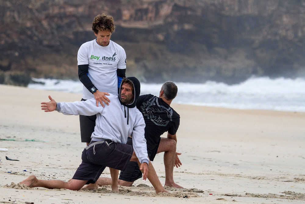 Andrew Blake training at Nazare beach with big wave surfers Garrett McNamara and Hugo Vau (PC SurfFit)