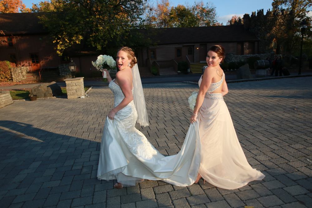 Bride and maid of honor posing for a fun picture