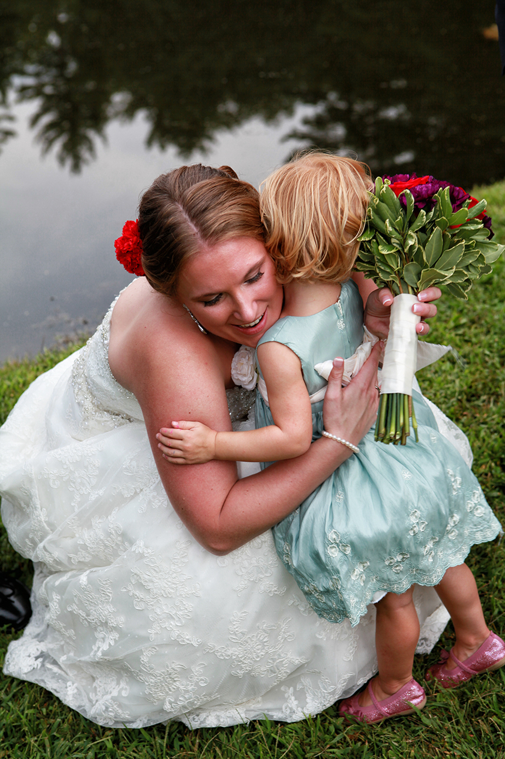 Bride hugging niece in Kingston