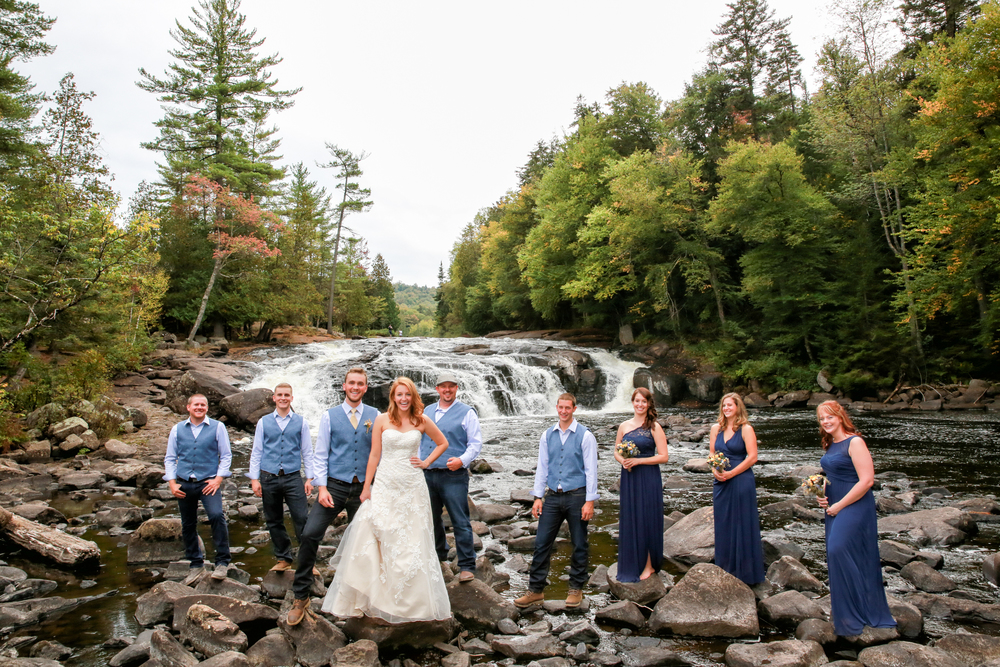 Photo of the wedding party at the Buttermilk Falls in Long Lake