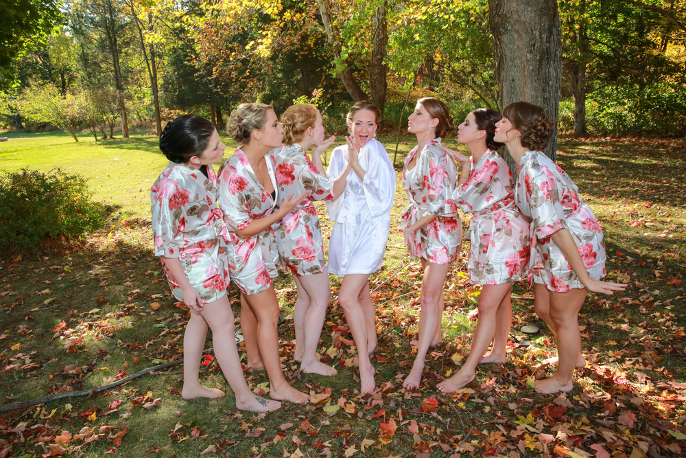 Photo of bride and her bridesmaids in silk ropes
