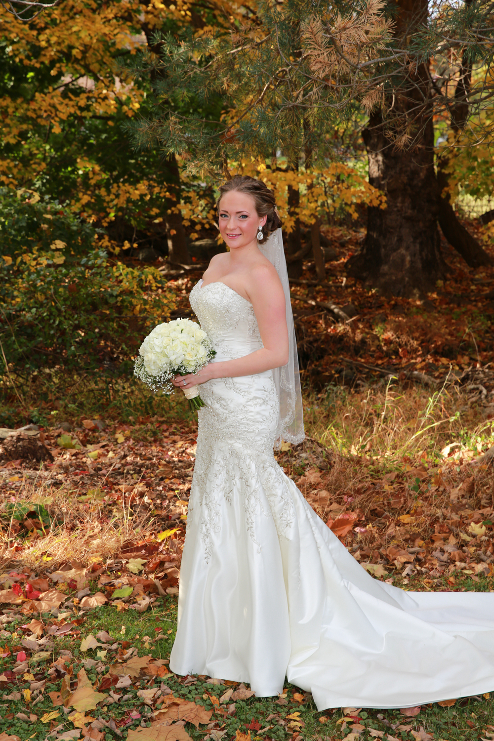 Photo of fall wedding portrait of bride.